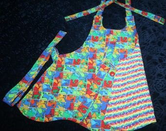 Girls Apron (S)  with Colorful Frog Print, Kangaroo Pocket secured in center with button. Lined (S)
