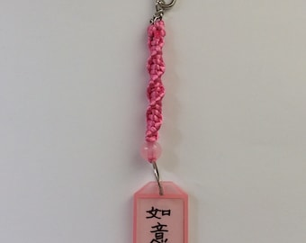 A Keychain  ( I wrote Chinese calligraphy on it . )