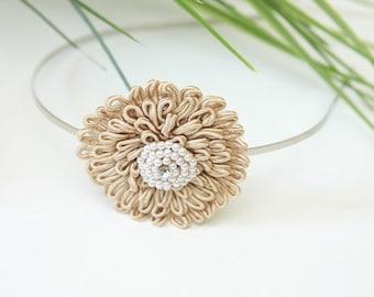 Lovely champagne flower with beaded center headband