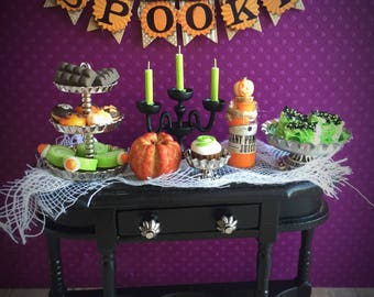 Spooky dollhouse treat display, miniature Halloween food and banner