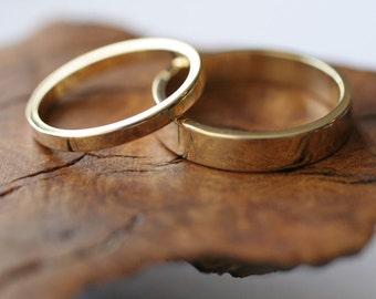 14k  gold flat band wedding ring set (2 rings)