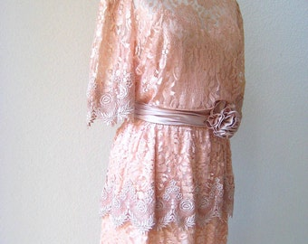 SALE 40% Off. vintage pretty in peach romantic lace dress with rosette sash by Miss Elliette.  size Large/X-Large