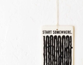 porcelain wall tag screenprinted text and river pattern start somewhere.