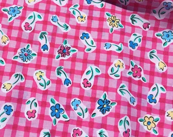 Small flowers on a pink gingham background. 1 5/8 yard piece.