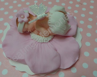BABY SHOWER Cake Topper Baby laying on a Fondant Flower with wings and head band