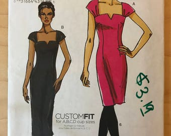 Vogue V8612 - Sheath Dress in Knee or Midi Length with Shaped Neckline and Cap Sleeves - Size 14 16 18 20