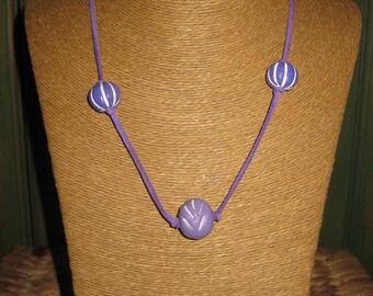 Mauve Beads on a mauve faux leather Cord