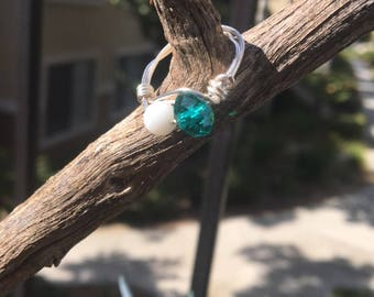 White and teal silver ring