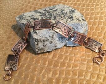 Copper Western style link bracelet .