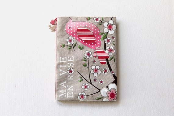 "Protects health book in illustrated natural linen ""life in pink"""