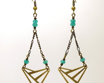 Earrings brass hanging brass and turquoise faceted glass beads.