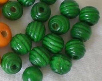 7 green wood beads