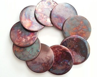 One Raku pottery fired Decorative art tile: Coaster Vibrant colored copper reds rainbow color variations round abstract unique tile