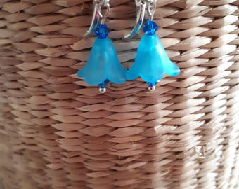 Drop flower earrings in blue with silver tone findings.