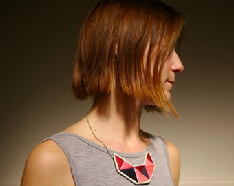 Small embroidered geometric bib necklace in beautiful pinks oxblood red and dark blue