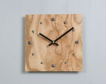 Oak Plywood clock with stainless steel hour markers and Tung oil finish.  USPS priority shipping to USA included