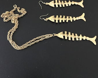 1960's yellow metal fish bones set pendant with chain and matching earrings.