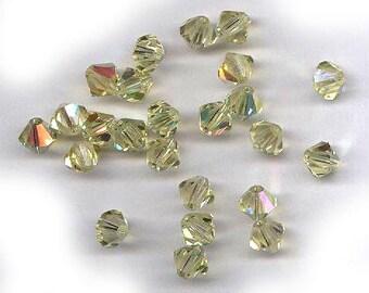 25 vintage swarovski crystal bicones in old art. 5301, jonquil yellow AB K.S. Swarovski 6mm antique crystal
