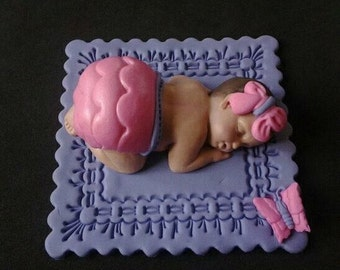 Fondant baby girl on a purple/pink cake topper for Baby Shower, Birthday, Party Favor