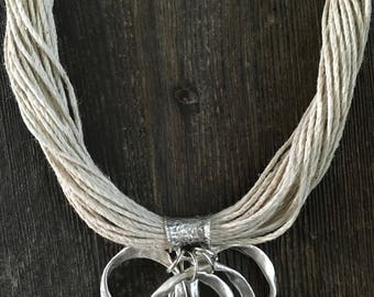Multi Strand Natural Ivory Hemp Statement Necklace with Twisted Silver Ring Pendant