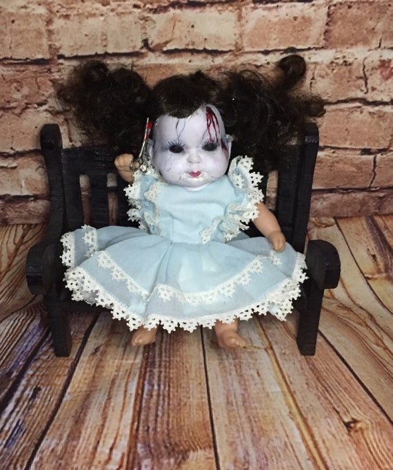 Doll Face Undead Party Dressed Black Eyed Serial Killer Scissor Wielding Bench Sitting Biohazard Baby