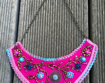 pink felt embroidered with beads bib necklace in the shape of flowers