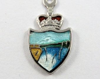 Enameled Niagara Falls with Crown Above Sterling Silver Charm of Pendant.
