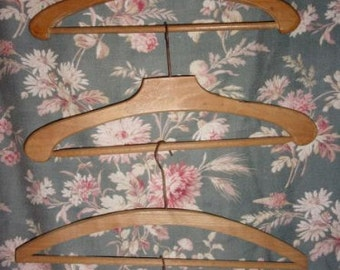 4 antique wood hangers