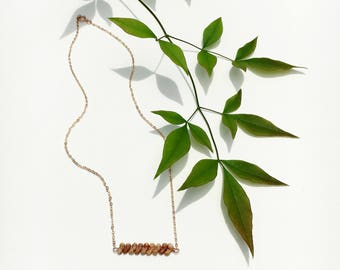 Kahelelani (Ni'ihau) shell bar on a gold filled or SS cable chain