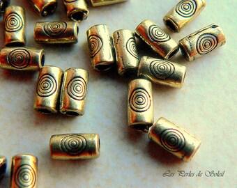 25 perles petits tubes en metal couleur bronze antique  5.5X3mm