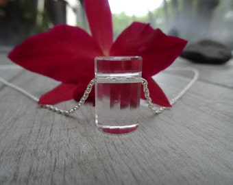 Clear and smooth quartz pendant. Sterling silver chain.