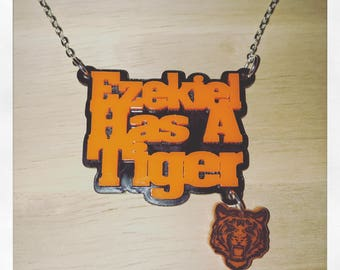 Walking Dead Inspired Ezekiel Has A Tiger Acrylic Necklace with Charm
