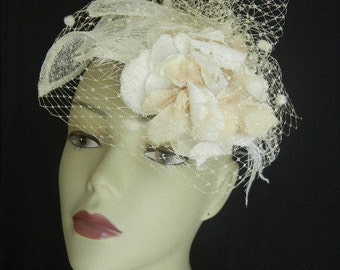 Ivory/ white Fascinator with flower and veil