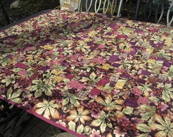 Burgundy, tan and green fall print lap quilt
