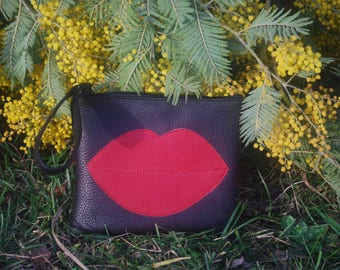 Black and red leather clutch