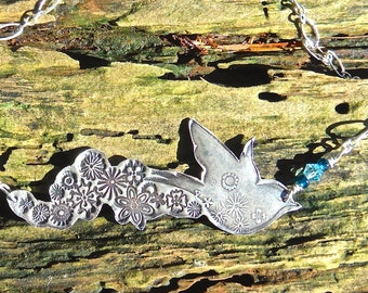 Bird of Joy Necklace. Sterling silver wide pendant with glass accent beads. Sterling silver chain.