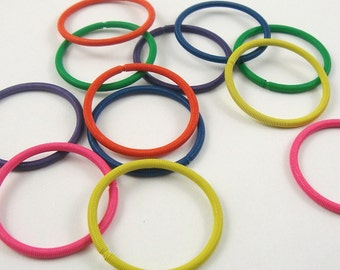 tiny mini wire ring springs .  6 colors . 24 pieces . colored metal