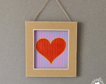 Cardboard frame painted red heart on purple background