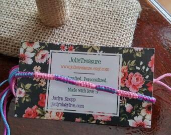 Light pink, blue, and dark pink square knots pattern friendship bracelet
