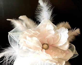 White and light pink fascinator