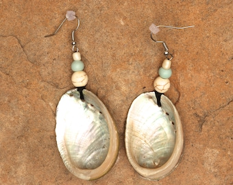 Very lightweight, shimmering abalone shell earrings with seafoam green and cream beads.