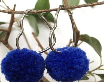 Heart shaped hoop pom pom earrings