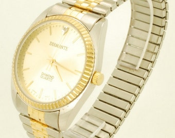 Diamante quartz wrist watch, heavy gold-toned & stainless steel cushion-shaped case, matching expansion band, boxed