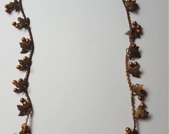 Copper necklace with grape motif