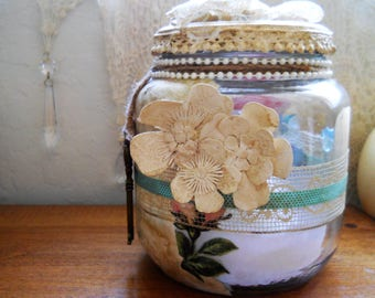 Glass storsge jar decoupaged with paper,pearls,jute,vintage lace and button,ribbon with faux key. Great for keepsakes.