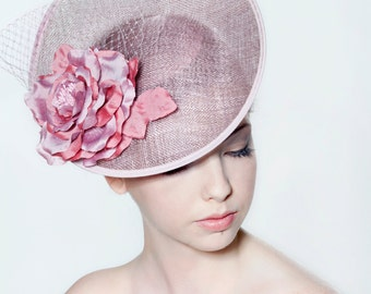 Sinamay saucer with open silk rose and veiling perfect for a wedding or the races.