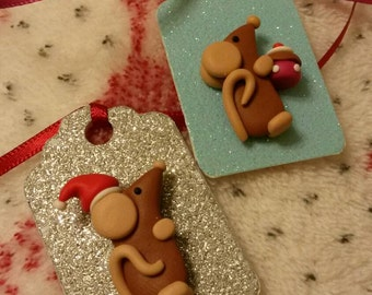 2 gift tags.. Decorated with Fimo Ratty Rats. One for Christmas and one for Birthday.