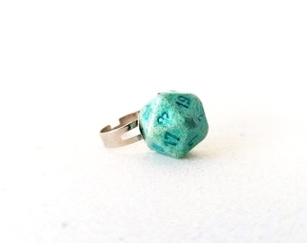 Individually cast clear resin D20 dice ring with green glitter and iridescent pigment powder