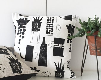 Botanics and ceramics cushion on white linen union