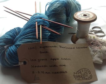 Wool.  Hand dyed Superwash 100% Blue Faced Leicester sock yarn